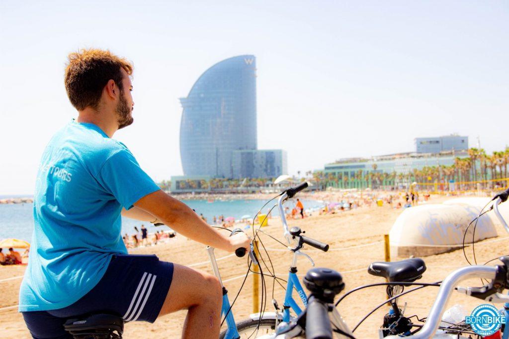 An image containing sky, exterior, person, terrain, beach, bike of born bike tours barcelona