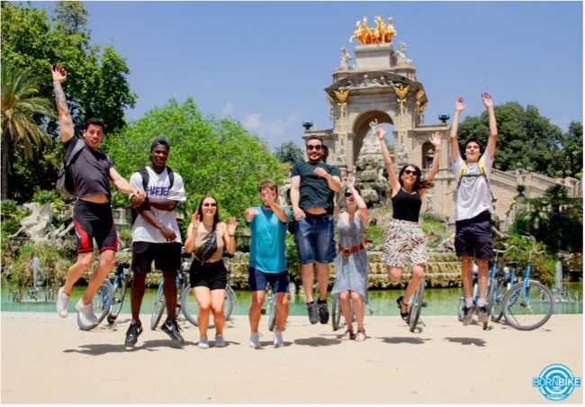 an image that contain park, nature, people, bikes, born bike tours Barcelona, text