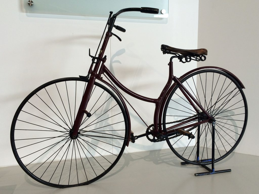 modern bicycle with a chain, equal wheels size and pedals in the middle